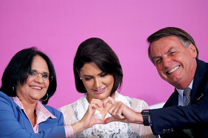 Brazil's Minister of Women, Family and Human Rights Damares Alves, President Jair Bolsonaro and his wife Michelle Bolsonaro react during a ceremony marking the International Women's Day at Planalto Palace in Brasilia, Brazil March 6, 2020. REUTERS/Adriano Machado TPX IMAGES OF THE DAY