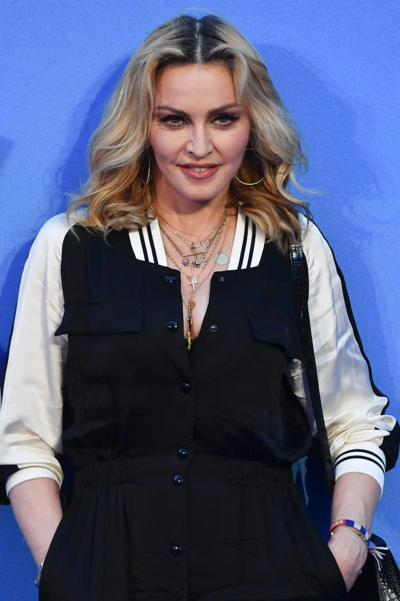 "US singer-songwriter Madonna poses arriving on the carpet to attend a special screening of the film ""The Beatles Eight Days A Week: The Touring Years"" in London on September 15, 2016. / AFP PHOTO / Ben STANSALL (Photo credit should read BEN STANSALL/AFP via Getty Images)"