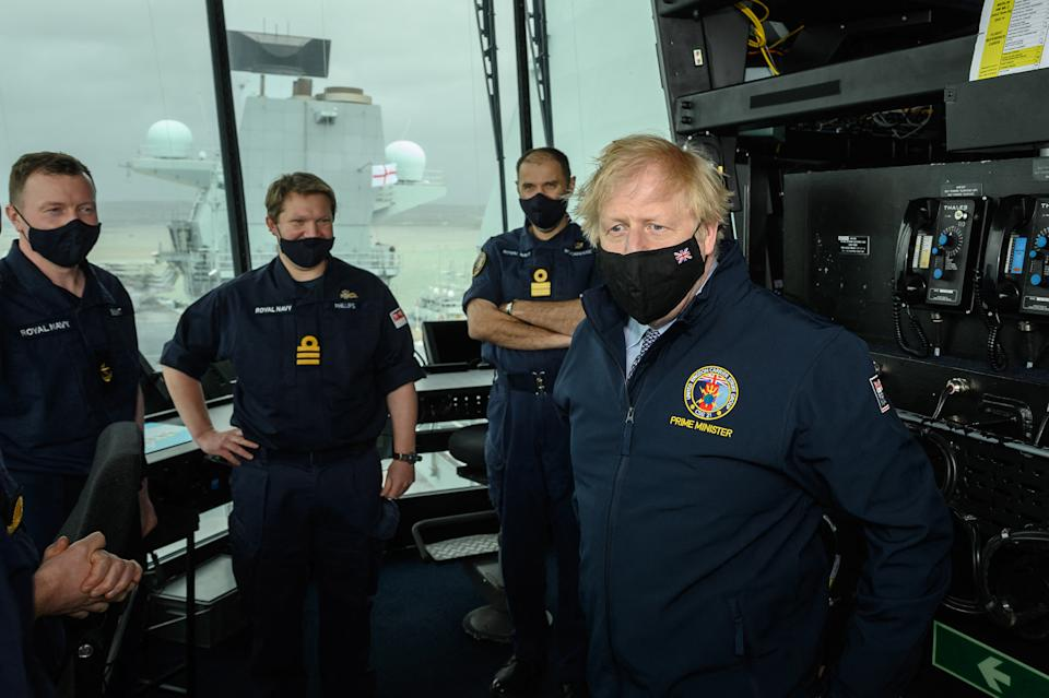 British Prime Minister Boris Johnson speaks with members of the crew during a visit to HMS Queen Elizabeth aircraft carrier in Portsmouth southwest England prior to its departure for Asia in its first operational deployment on May 21, 2021. (Photo by Leon Neal / POOL / AFP) (Photo by LEON NEAL/POOL/AFP via Getty Images)