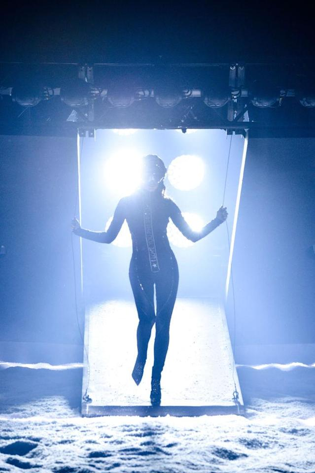 <p>Irina Shayk makes her entrance from the spaceship. (Photo: Getty) </p>