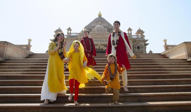 The family have been criticised for the numerous staged photos of them wearing traditional Indian clothing (AP)