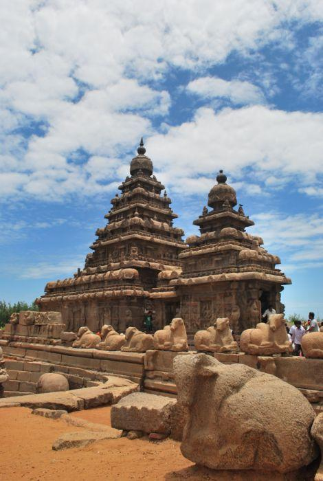<b>Another view of the Shore Temple</b><br>Our history books have taught us that seven pagodas or such temples were initially constructed and the lone survivor is today a UNESCO World heritage Site. Built by the Pallavas, there are three temples here – two dedicated to Shiva and the other to Vishnu. Here the sculpture of Vishnu is found sleeping, hence the deity is known as Sthala Shayana Perumal or Ananthasayana. It is said that Vishnu reclines on the floor listening silently to the sounds of names. It is pretty dark in there and one has to strain to catch the glimpse of the God asleep. An unfinished enclosure, with rows of sculpted Nandis, greets you. Recent excavations have unearthed various sculptures and shrines near the temple.