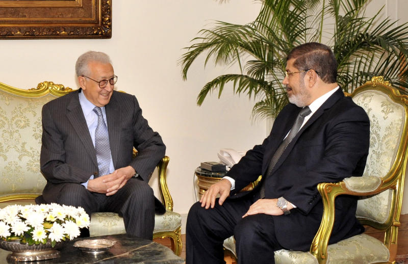 In this image released by the Egyptian Presidency, U.N.-Arab League envoy, Lakhdar Brahimi, left, meets Egyptian President Mohammed Morsi, in Cairo, Egypt, Monday, Sept. 10, 2012. Brahimi, who is tasked with brokering a diplomatic solution to the Syrian conflict, replaced former U.N. Secretary-General Kofi Annan, who stepped down in August in frustration after his six-point peace plan collapsed. Brahimi, said he will travel to Syria this week to meet with regime officials as well as representatives of civil society. (AP Photo/Egyptian Presidency)