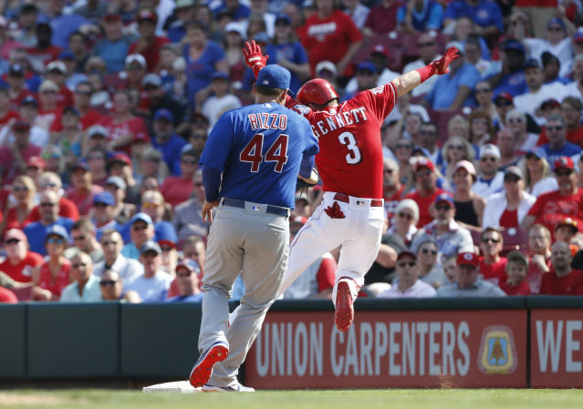 Chicago Cubs first baseman Anthony Rizzo (44) gets the tag on Cincinnati Reds' Scooter Gennett (3) for an out during the fourth inning of a baseball game, Saturday, June 29, 2019, in Cincinnati. (AP Photo/Gary Landers)