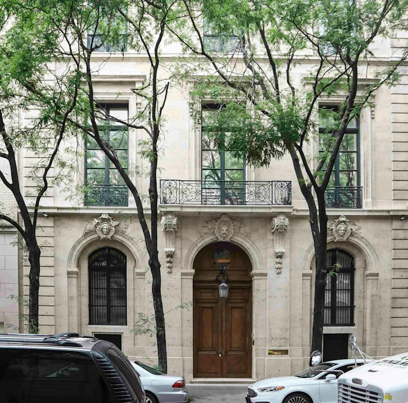 """This photo shows the Manhattan residence of Jeffrey Epstein, Monday July 8, 2019, in New York. Prosecutors said Monday, federal agents investigating wealthy sex offender Jeffrey Epstein found """"nude photographs of what appeared to be underage girls"""" while searching his Manhattan mansion."""