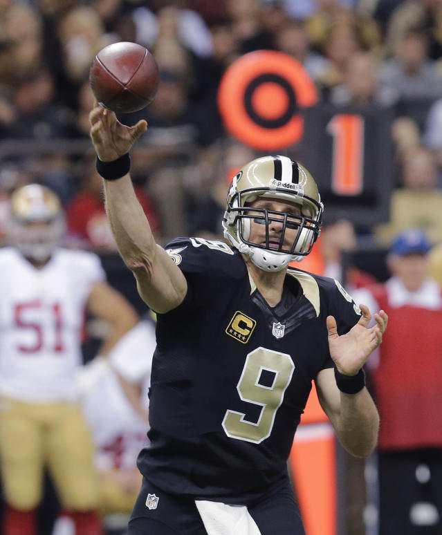 New Orleans Saints quarterback Drew Brees (9) passes in the first half of an NFL football game against the San Francisco 49ers in New Orleans, Sunday, Nov. 17, 2013. (AP Photo/Bill Haber)