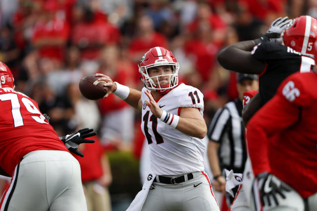 Georgia quarterback Jake Fromm (11) throws from the pocket during the first half of the annual G day intrasquad spring college football game Saturday, April 21, 2018, in Athens, Ga. (AP Photo/John Bazemore)