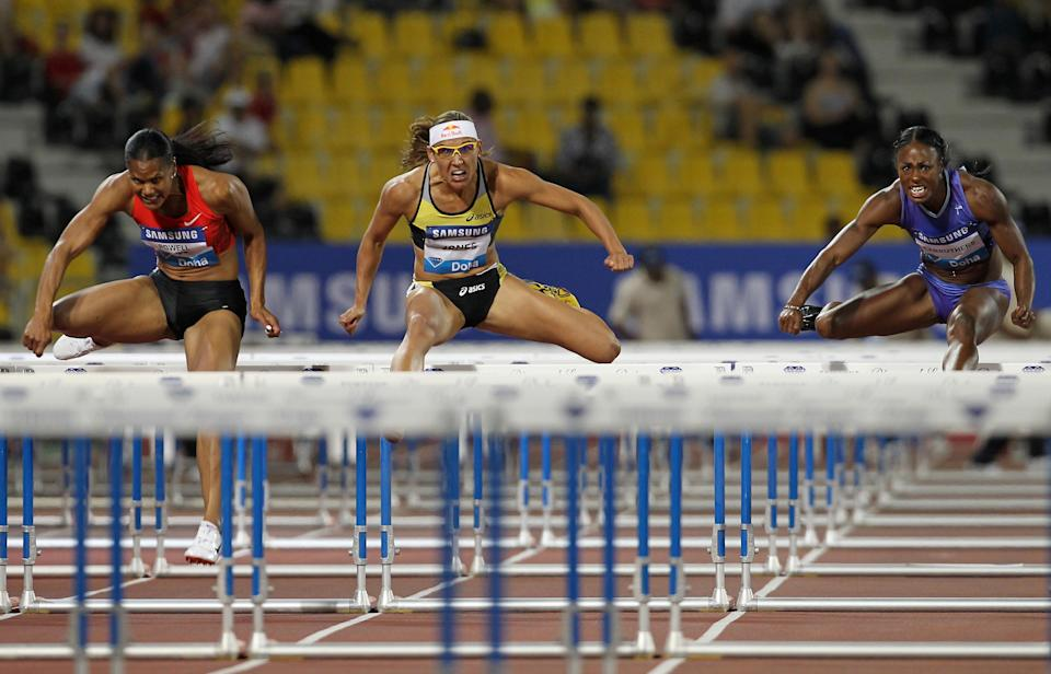 (L-R) Virginia Powell-Crawford, Lolo Jones and Danielle Carruthers of the US compete in the women's 100m hurdles at the IAAF Diamond League in Doha on May 6, 2011. (KARIM JAAFAR/AFP/Getty Images)