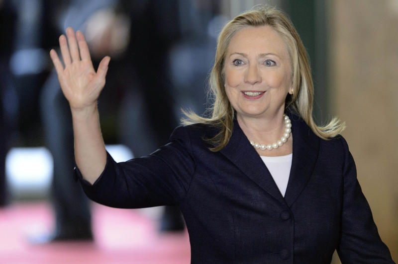 US Secretary of State Hillary Rodham Clinton waves as she arrives for a meeting of the Action Group for Syria at the European headquarters of the United Nations, in Geneva, Switzerland, Saturday, June 30, 2012. The United States and Russia failed on Friday to bridge differences over a plan to ease Syrian President Bashar Assad out of power, end violence and create a new government, setting the stage for the potential collapse of a key multinational conference that was to have endorsed the proposal. (AP Photo/Keystone, Laurent Gillieron)