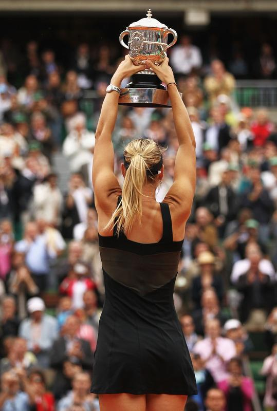 PARIS, FRANCE - JUNE 09: Maria Sharapova of Russia celebrates with the Coupe Suzanne Lenglen in the women's singles final against Sara Errani of Italy during day 14 of the French Open at Roland Garros on June 9, 2012 in Paris, France. (Photo by Matthew Stockman/Getty Images)