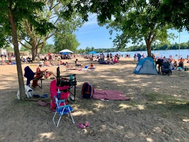 People packed the beach at Mooney's Bay Park on Saturday. (Natalia Goodwin/CBC  - image credit)