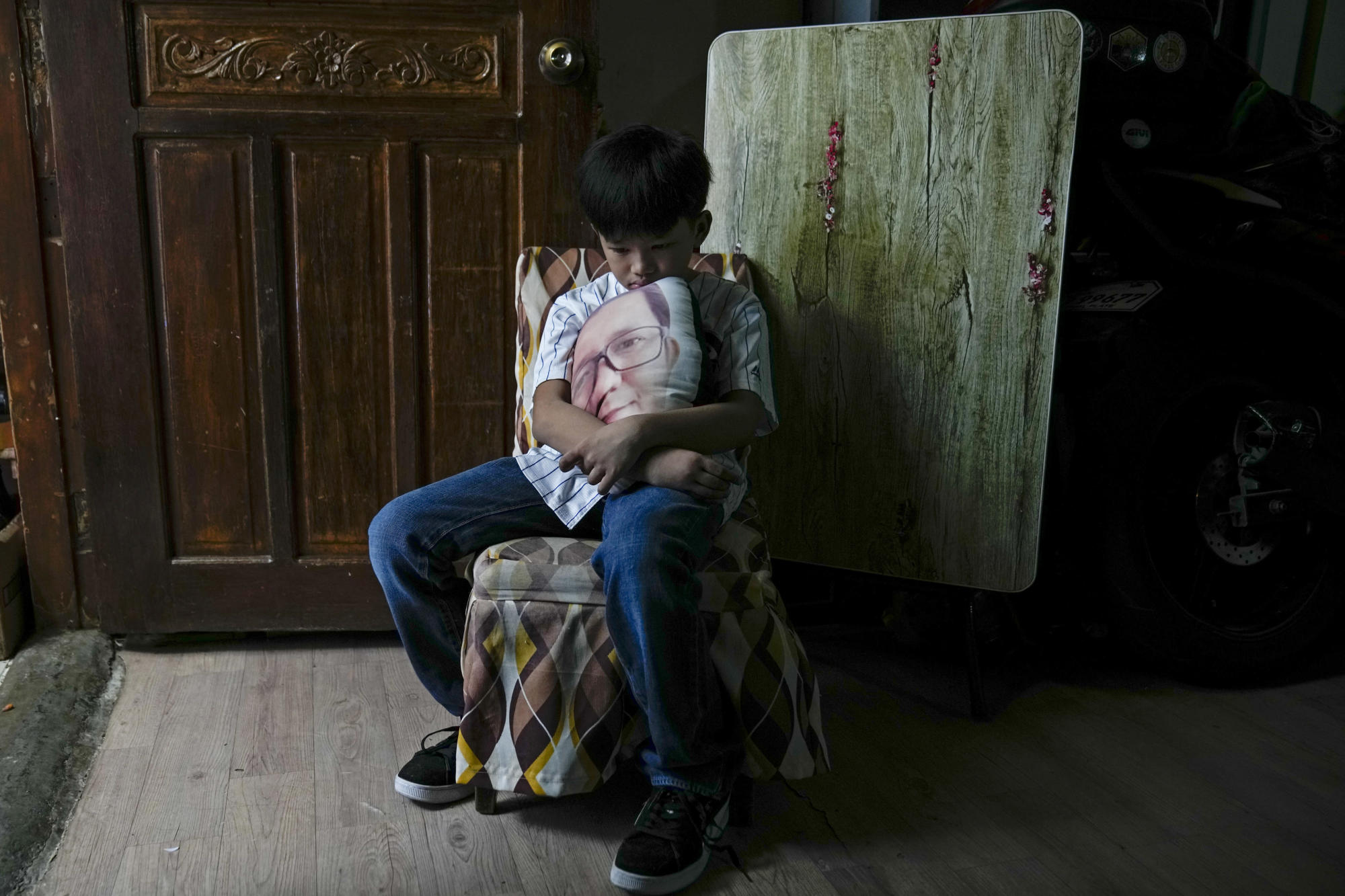 AP PHOTOS: With 4 million COVID dead, many kids left behind