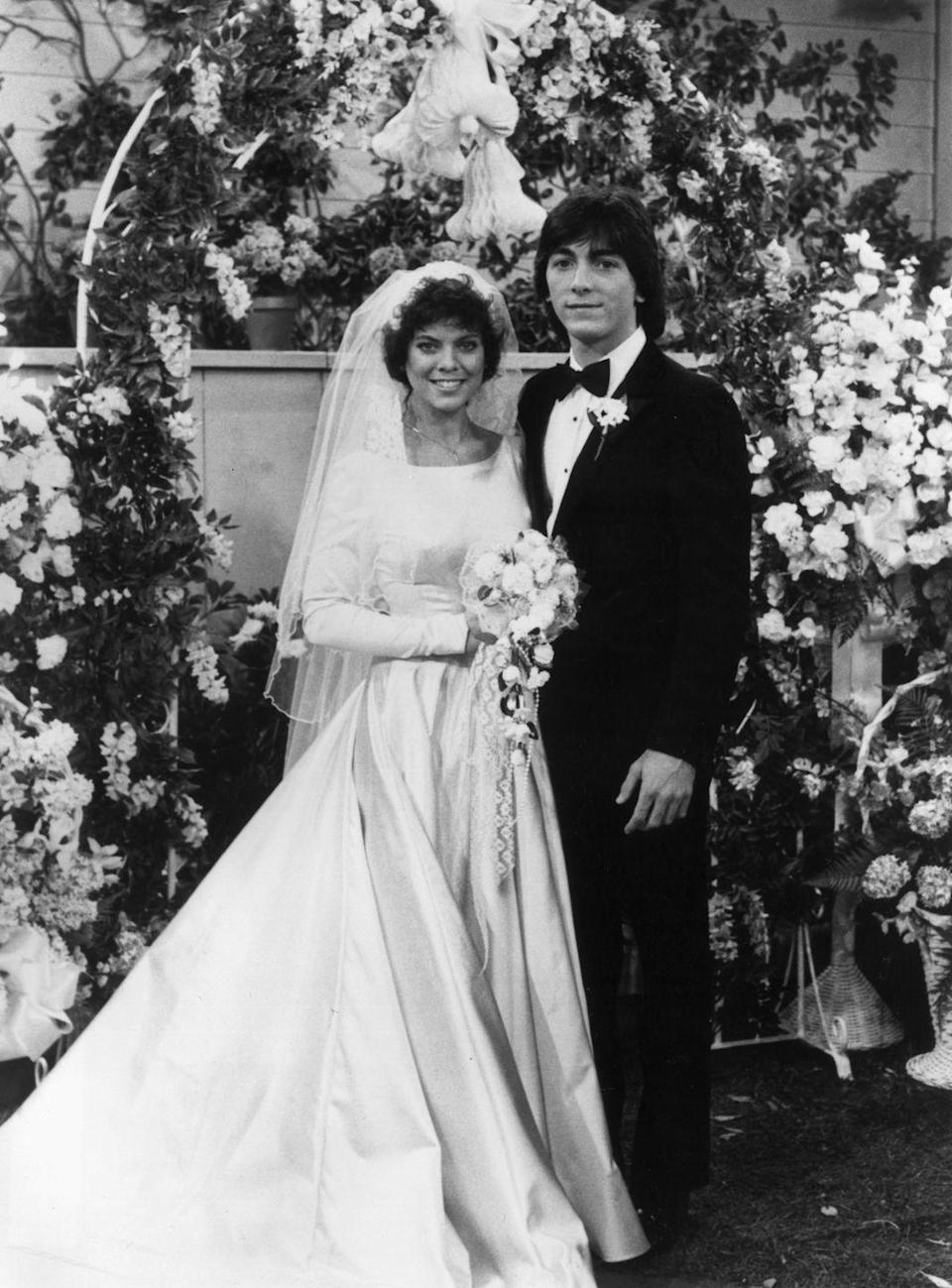 <p>By the end of <em>Happy Days, </em>it was official: Joanie loved Chachi. The couple got married in the series finale and the bride wore a long-sleeve bateau neck satin gown with a waterfall bouquet. </p>