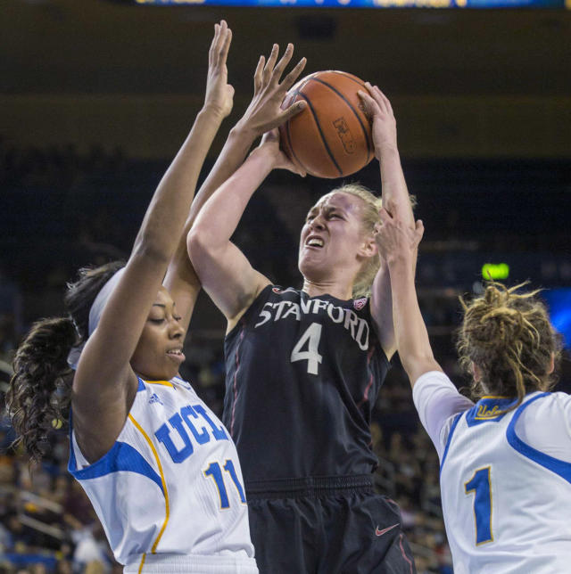 Stanford forward Taylor Greenfield, center, goes up against UCLA forward Atonye Nyingifa, left, and guard Thea Lemberger, right, in the first half of an NCAA college basketball game, Sunday, Feb. 23, 2014 in Los Angeles. (AP Photo/Ringo H.W. Chiu)