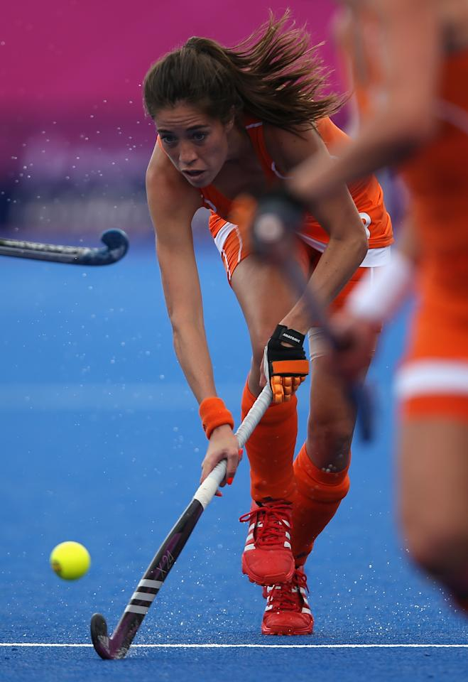 LONDON, ENGLAND - JULY 29:   Naomi Van As of Netherlands competes during the Women's Pool WA Match W02 between the Netherlands and Belgium at the Hockey Centre on July 29, 2012 in London, England.  (Photo by Daniel Berehulak/Getty Images)