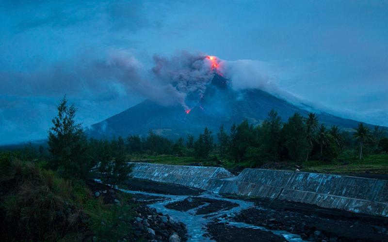 The Mayon volcano lies 210 miles southeast of Manila - STR