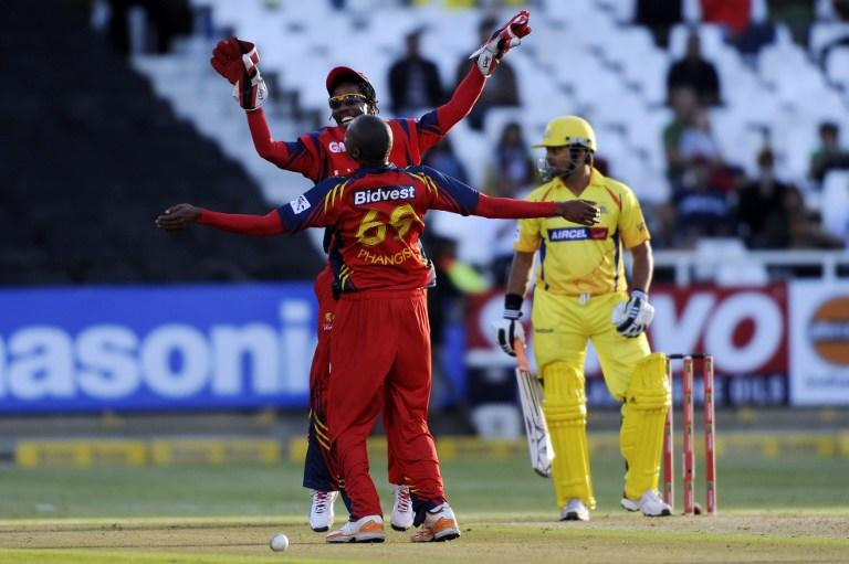 Highveld Lions wicketkeeper Thami Tsolekile and bowler Aaron Phangiso celebrate a caught-and-bowled on October 16, 2012 during Match 7 of the Champions League T20 (CLT20) between the Chennai Super Kings (India) and the Highveld Lions (South Africa) at  the Newlands Cricket Stadium in Cape Town. AFP PHOTO / Roger Sedres