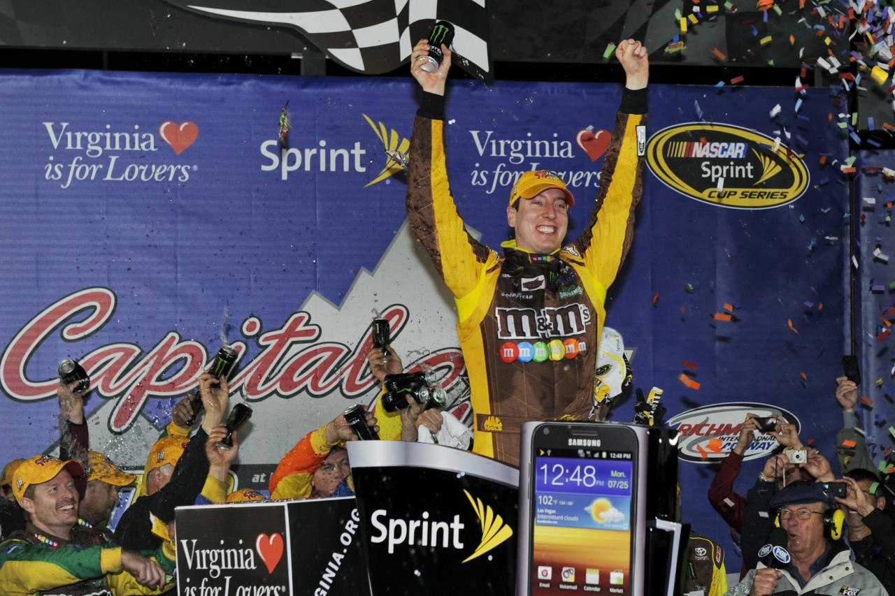 Kyle Busch celebrates winning the NASCAR Sprint Cup Series auto race at Richmond International Raceway in Richmond, Va., Saturday, April 28, 2012. (AP Photo/Clemment Britt)