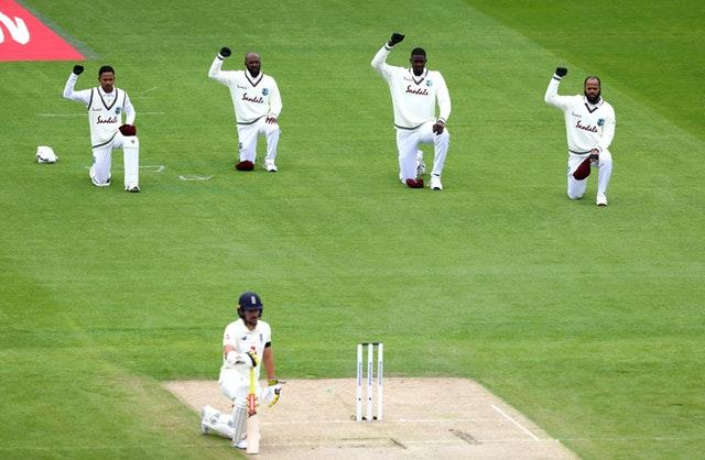 England's Rory Burns joins the West Indies in taking a knee.