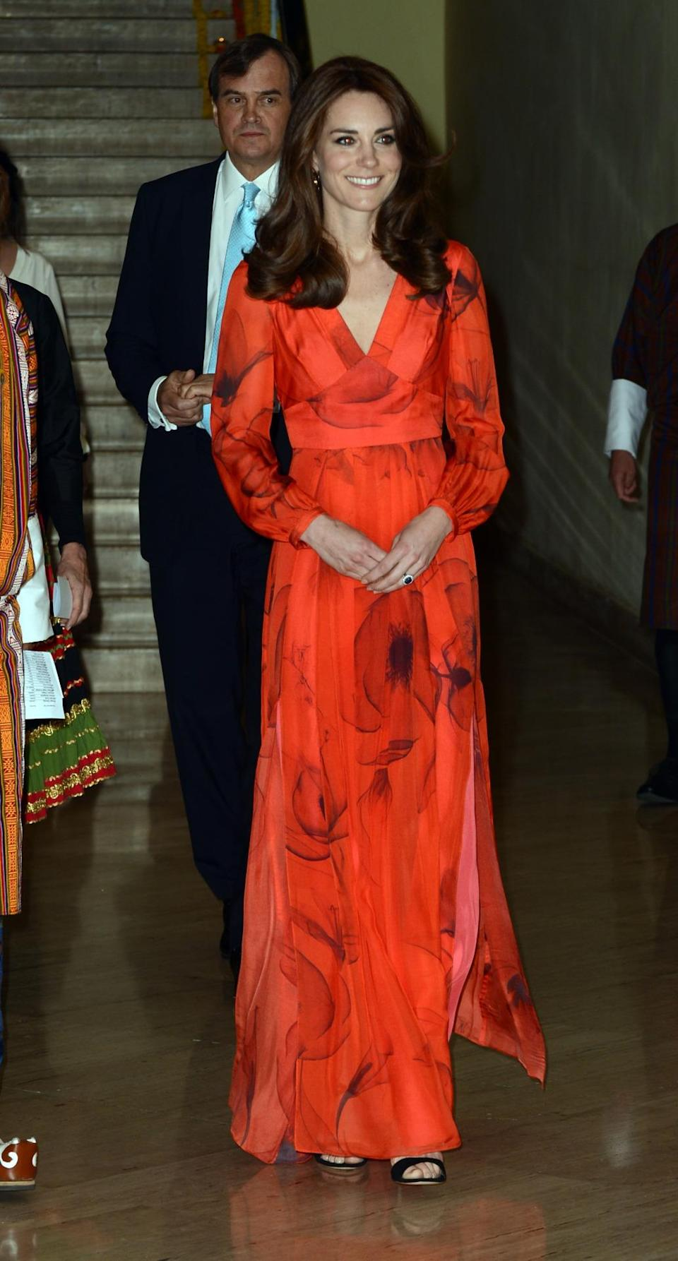 <p>Kate looked exquisite in a red chiffon gown by Beulah London. Complete with an abstract poppy print, the Duchess accessorised with Gianvito Rossi sandals. </p><p><i>[Photo: PA]</i></p>