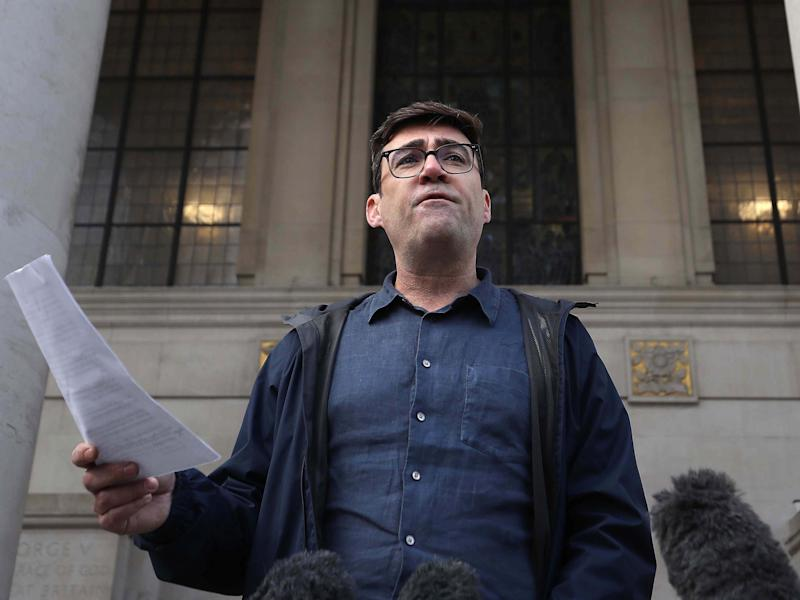 Greater Manchester mayor Andy Burnham speaking to the media outside the Central Library in Manchester, he has threatened legal action if Tier 3 restrictions are imposed without agreement (PA)