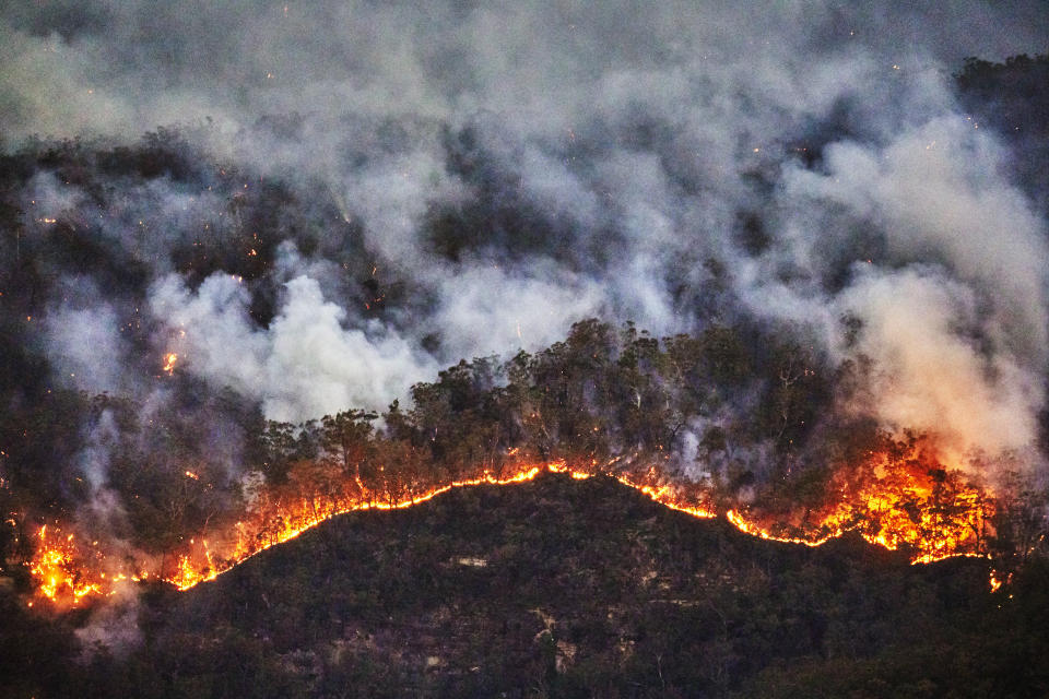 A new study suggests that an increase in global temperatures may lead to increased death in the U.S. Pictured above, wildfires in Australia. (Photo: Getty Images).