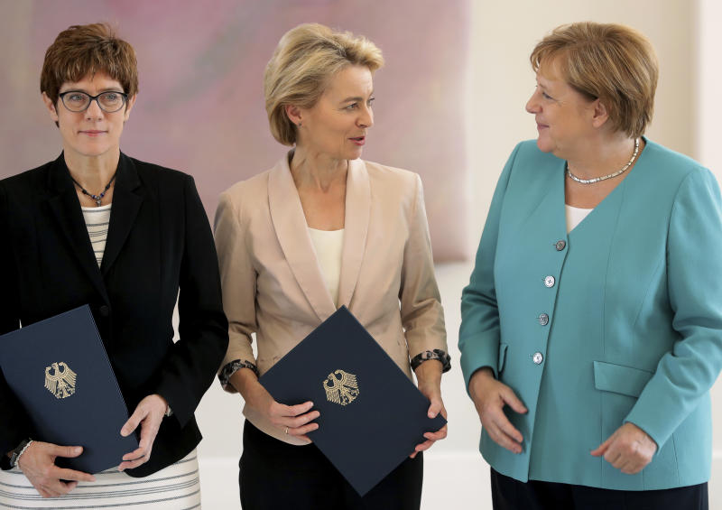 From right, German Chancellor Angela Merkel, new elected European Commission President Ursula von der Leyen and Annegret Kramp-Karrenbauer, von der Leyen's successor as German Defense Minister, line up for a group photo after an office over ceremony at the Bellevue Palace in Berlin, Germany, Wednesday, July 17, 2019. (AP Photo/Michael Sohn)