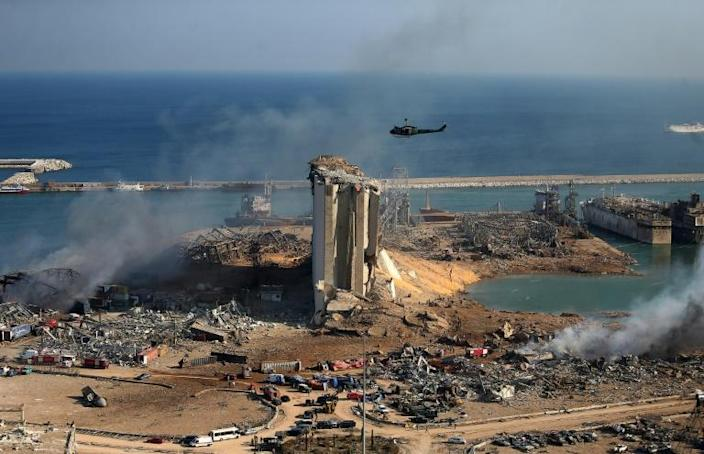 The damaged grain silos of Beirut's harbour and its surroundings one day after a powerful twin explosion tore through Lebanon's capital (AFP Photo/STR)