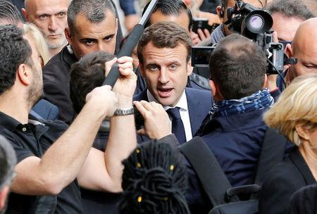 Emmanuel Macron, head of the political movement En Marche !, or Onwards !, and candidate for the 2017 presidential election, speaks with supporters during a campaign visit in Rodez