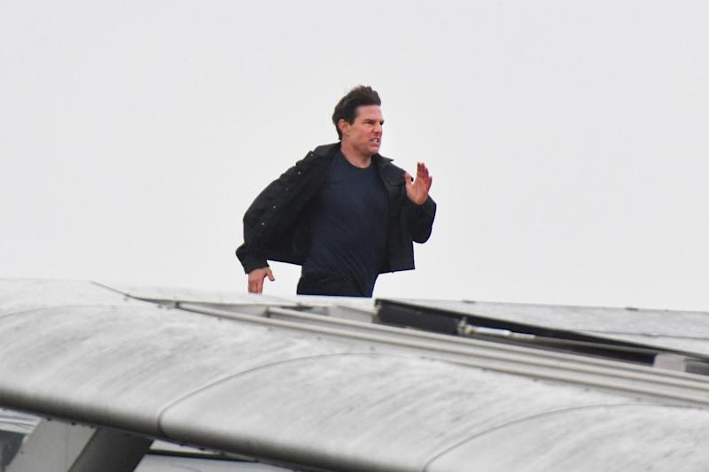 Tom Cruise runs along the rooftop of Blackfriars station in London (PA)