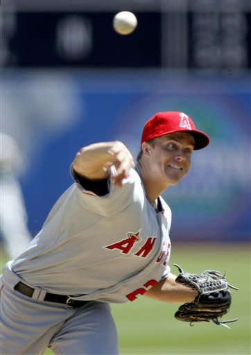 Los Angeles Angels pitcher Zack Greinke throws to the Oakland Athletics in the first inning of a baseball game in Oakland, Calif., Wednesday, August 8, 2012. (AP Photo/Dino Vournas)
