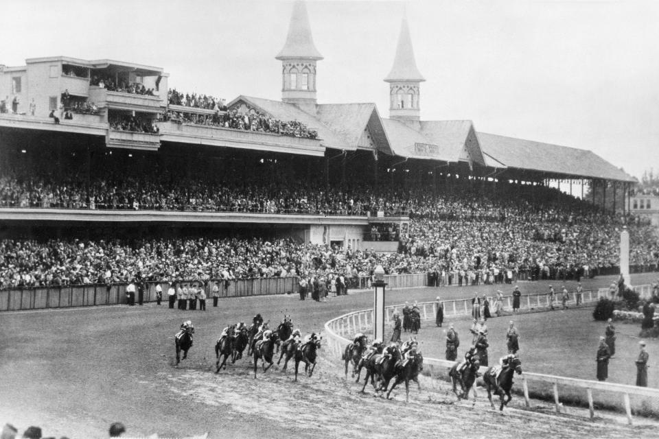 FILE - In this June 9, 1945, file photo, Hoop Jr. leads by a length during the 71st running of the Kentucky Derby horse race at Churchill Downs in Louisville, Ky. This year is the first time the Derby won't be held on the first Saturday in May since 1945, when it was run June 9. Starting in 1930, the term Triple Crown became popular in referring to the three races and since 1931, the Derby, Preakness and Belmont have been run in that order. It's possible that the Derby could be the final of the three races this year. (AP Photo/File)