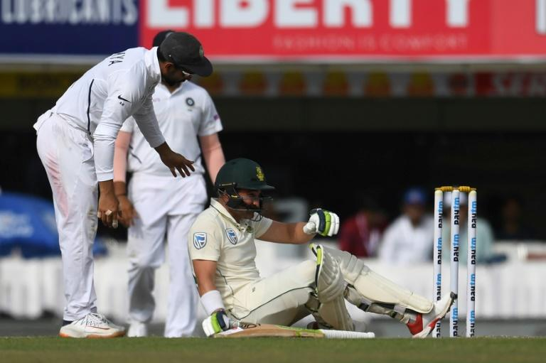 South African Dean Elgar was floored by a delivery from Umesh Yadav and had to retire hurt as the tourists followed on in Ranchi