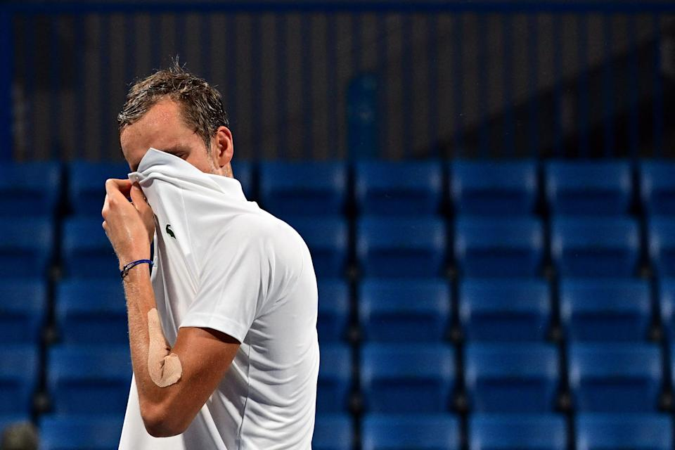 Russia's Daniil Medvedev wipes his face as he competes against Spain's Pablo Carreno Busta during their Tokyo 2020 Olympic Games men's singles quarterfinal tennis match at the Ariake Tennis Park in Tokyo on July 29, 2021. (Photo by Vincenzo PINTO / AFP) (Photo by VINCENZO PINTO/AFP via Getty Images)