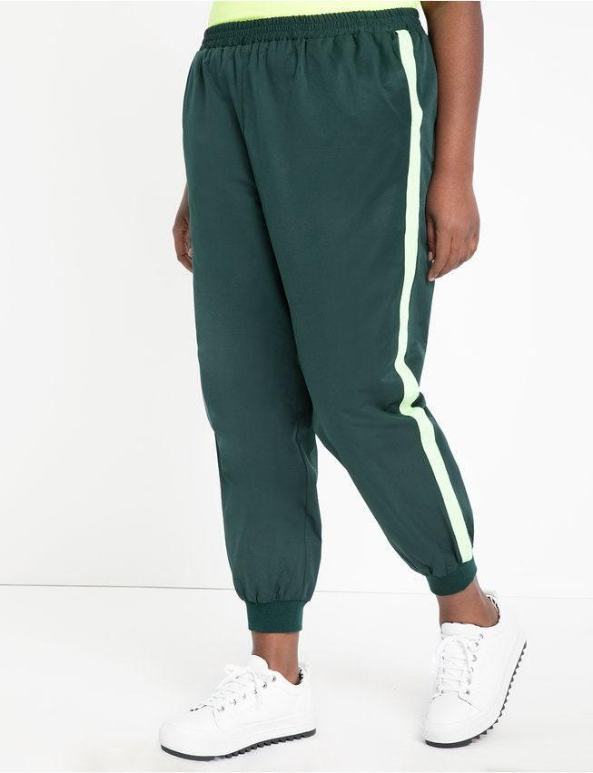 """Throwback pastimes like sports in the park are one of the safe activities to pursue right now, and these track pants fit the bill. <a href=""""https://www.eloquii.com/track-jacket-with-peplum/1278001.html?dwvar_1278001_colorCode=45"""" rel=""""nofollow noopener"""" target=""""_blank"""" data-ylk=""""slk:There's a matching track jacket too"""" class=""""link rapid-noclick-resp"""">There's a matching track jacket too</a>, if your """"add to cart"""" finger feels particularly eager. $80, Eloquii. <a href=""""https://www.eloquii.com/jogger-with-side-stripe/1185002.html?dwvar_1185002_colorCode=45"""" rel=""""nofollow noopener"""" target=""""_blank"""" data-ylk=""""slk:Get it now!"""" class=""""link rapid-noclick-resp"""">Get it now!</a>"""