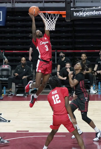 Houstons's Houstons's DeJon Jarreau (3) takes a shot over Temple's Khalif Battle (0) in the first half of an NCAA college basketball game, Saturday, Jan. 23, 2021, in Philadelphia. (AP Photo/Michael Perez)