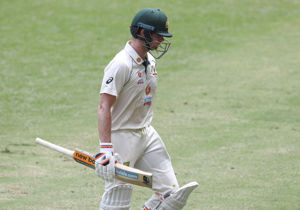Australia's Steve Smith walks from the field after he was dismissed during play on day four of the fourth cricket test between India and Australia at the Gabba, Brisbane, Australia, Monday, Jan. 18, 2021. (AP Photo/Tertius Pickard)