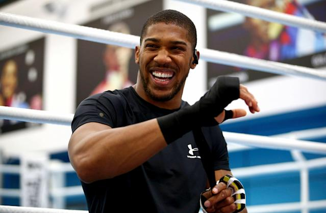 British boxer Anthony Joshua laughs prior to a media session on May 1, 2019. He'll face Andy Ruiz Jr. in New York on Saturday. (AP)
