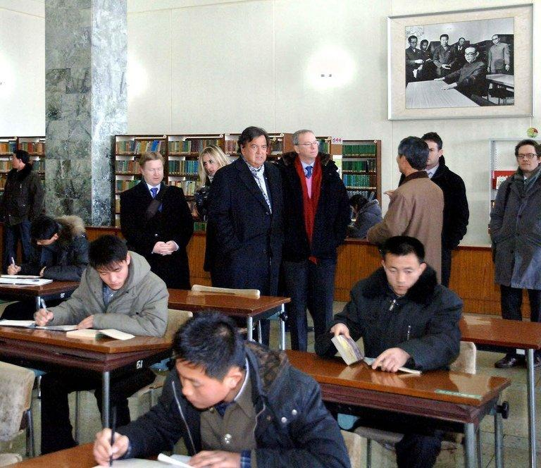 Bill Richardson (C-R) and Eric Schmidt (C-L) at the Grand People's Study House in Pyongyang on January 9, 2013