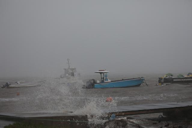 <p>Boats remain anchored in a wharf as Hurricane Maria approaches in Guadeloupe island, France, Sept. 18, 2017. (Photo: Andres Martinez Casares/Reuters) </p>
