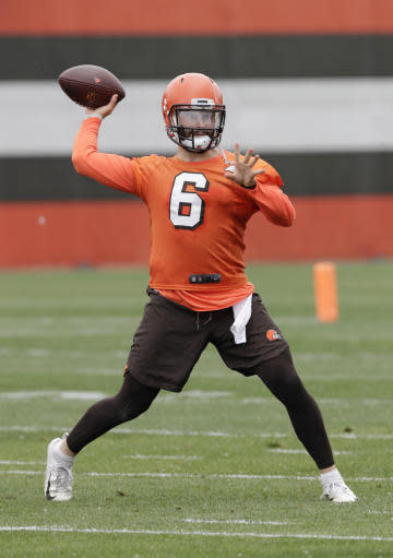 Cleveland Browns quarterback Baker Mayfield throws a pass during practice at the NFL football team's training camp facility, Tuesday, June 12, 2018, in Berea, Ohio. (AP Photo/Tony Dejak)