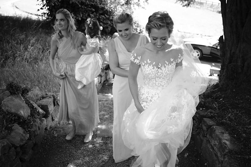 Excited nerves! My bridesmaid Victoria is helping me gather the layers of tulle of my dress and veil so I can get up the steps to the church.