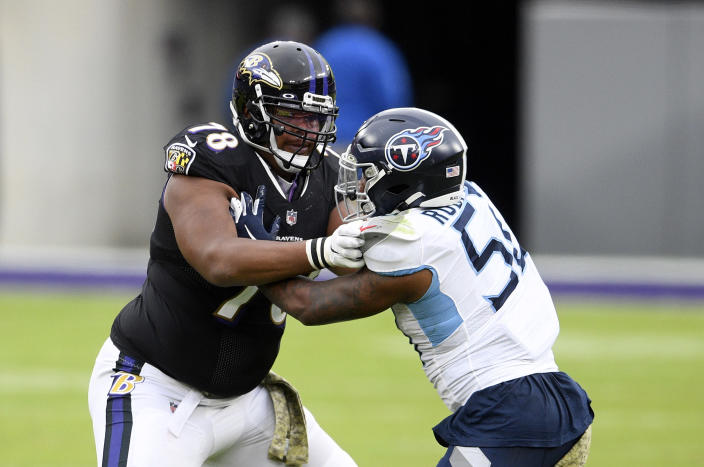FILE - In this Nov. 22, 2020, file photo, Baltimore Ravens offensive tackle Orlando Brown (78) works against Tennessee Titans linebacker Derick Roberson (50) during the second half of an NFL football game in Baltimore. The Kansas City Chiefs plugged the biggest hole remaining on their AFC champion roster Friday, April 23, 2021, when they acquired two-time Pro Bowl offensive tackle Brown from the Ravens for a package of draft picks, including the No. 31 overall selection this year. (AP Photo/Nick Wass, File)