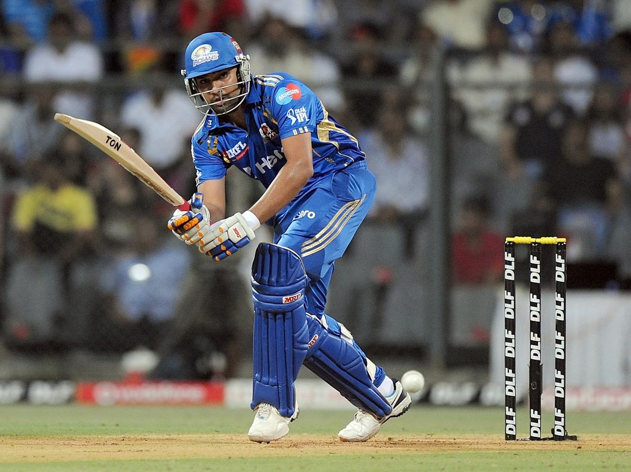 Mumbai Indians batsman Rohit Sharma plays a shot during the IPL Twenty20 cricket match between Mumbai Indians and Deccan Chargers at the Wankhede Stadium in Mumbai on April 29, 2012. RESTRICTED TO EDITORIAL USE. MOBILE USE WITHIN NEWS PACKAGE.  AFP PHOTO/Punit PARANJPEPUNIT PARANJPE/AFP/GettyImages