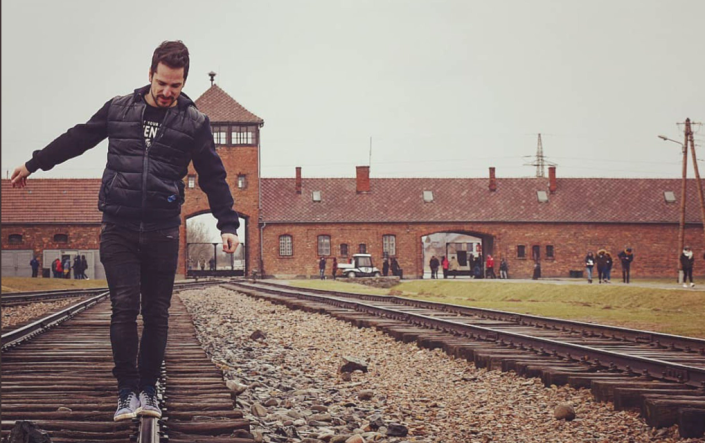 Auschwitz memorial and museum has issued a statement on Twitter asking visitors to stop playfully posing on train tracks. (Photo: Twitter)