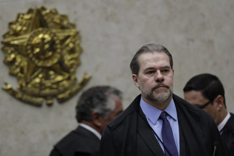 President of Brazil's Federal Supreme Court Dias Toffoli opens debate on whether a defendant is to begin serving his sentence after a conviction has been reached by the first appellate court, in Brasilia, Brazil, Thursday, Oct. 17, 2019. The Supreme Court's decision could affect cases like that of jailed former President Luiz Inacio Lula da Silva. (AP Photo/Eraldo Peres)