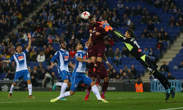 Soccer Football - Spanish King's Cup - Espanyol vs FC Barcelona - Quarter-Final - First Leg - RCDE Stadium, Barcelona, Spain - January 17, 2018 Barcelona's Gerard Pique in action with Espanyol's Diego Lopez REUTERS/Albert Gea TPX IMAGES OF THE DAY
