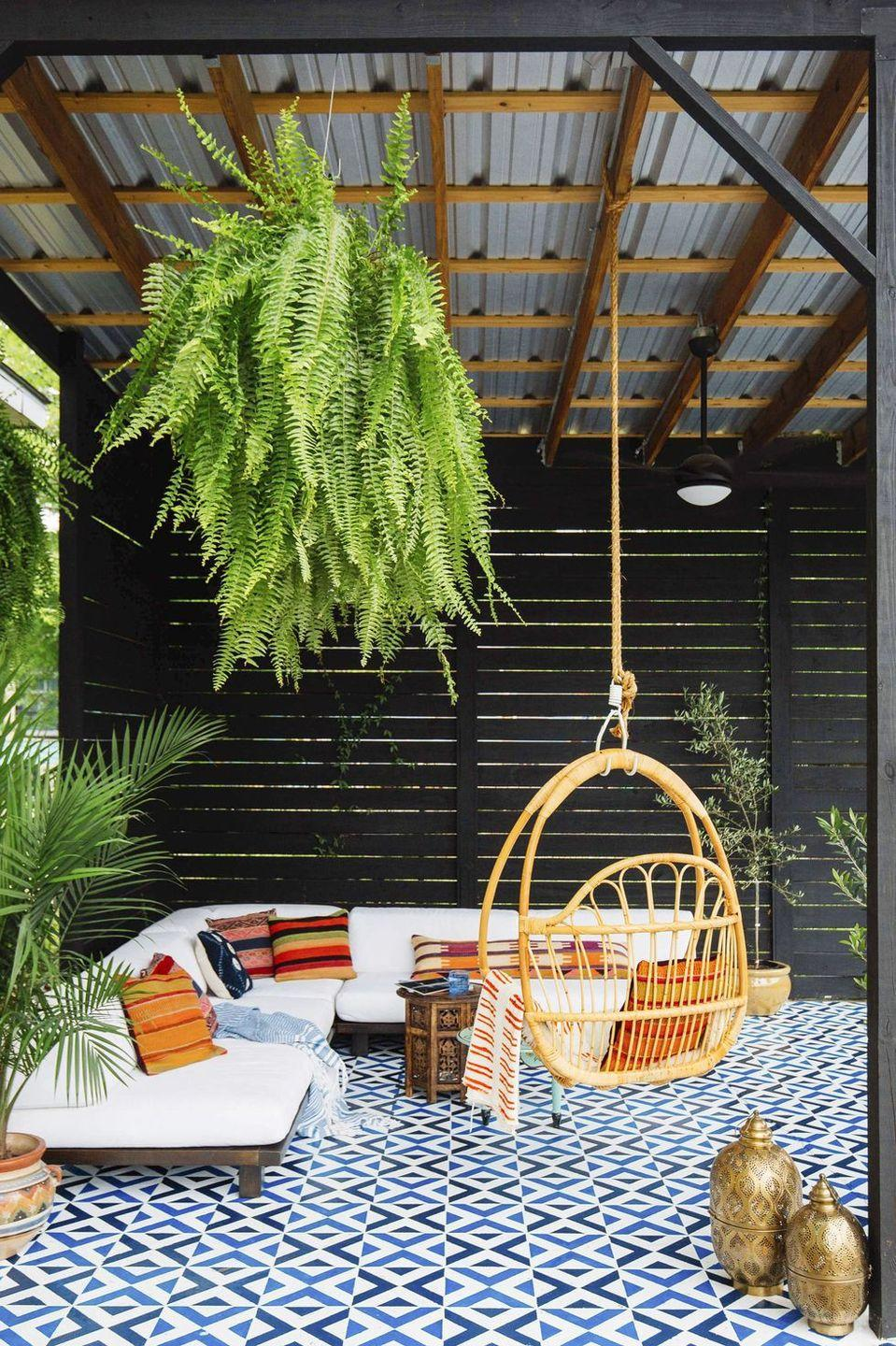 <p>Let your geometric tiling or outdoor rug make a statement by hanging a swing chair from the ceiling or deck cover. Not to mention that this boho-inspired hanging chair is ideal for curling up with a summer read or sipping on a seasonal cocktail. </p>