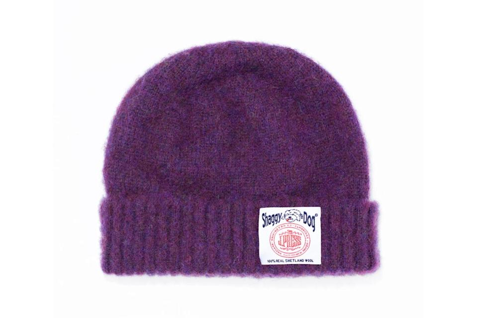 "$60, J.Press. <a href=""https://jpressonline.com/collections/hats-caps/products/shaggy-dog-cuffed-hat-purple"" rel=""nofollow noopener"" target=""_blank"" data-ylk=""slk:Get it now!"" class=""link rapid-noclick-resp"">Get it now!</a>"
