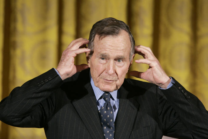 <p>Former President George H.W. Bush gestures while telling a story as he speaks during a presentation ceremony for the Hugh S. Sidey Scholarship in Print Journalism, at the White House on Jan. 26, 2007. Sidey was a White House correspondent for over three decades. (Photo: Charles Dharapak/AP) </p>
